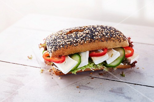 Sesame and poppy seed roll with camembert, vegetables and lettuce