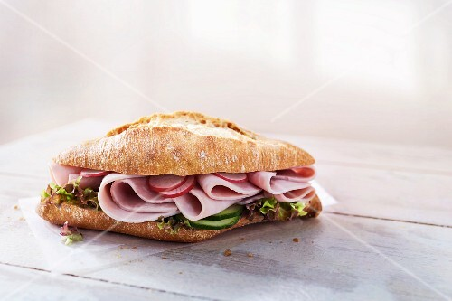 Ciabatta roll with ham, radishes, cucumber and lettuce