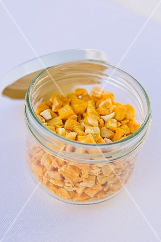 Freeze dried mango pieces in a jar