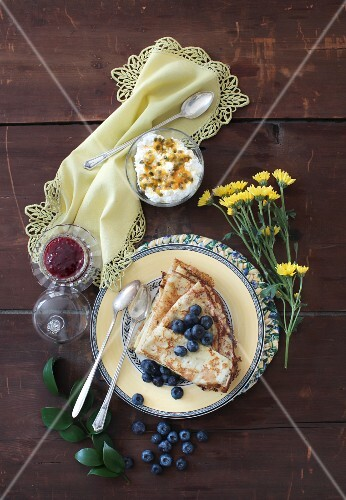 Vanilla crepes with blueberries, cottage cheese and passion fruit