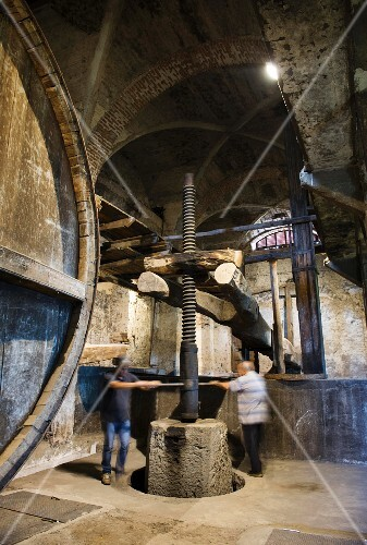 An old wine press in a wine cellar in Passopisciaro, Sicily, Italy