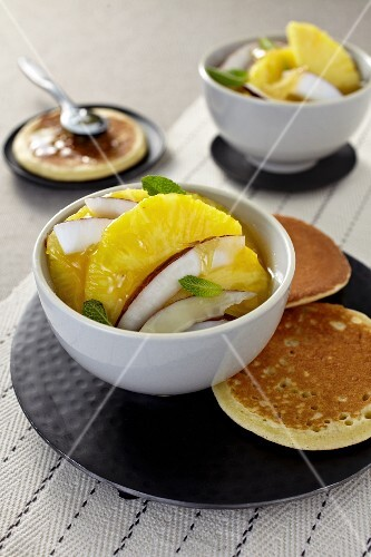 Pineapple and coconut salad with ginger, caramel and pancakes (Asia)