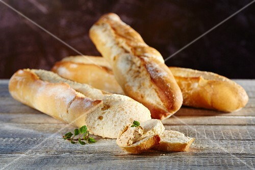 French wheat baguettes with a dip and oregano