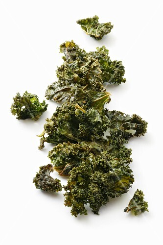 Kale chips on a white surface