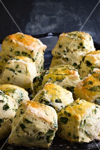 Freshly baked scones with herbs on a baking tray