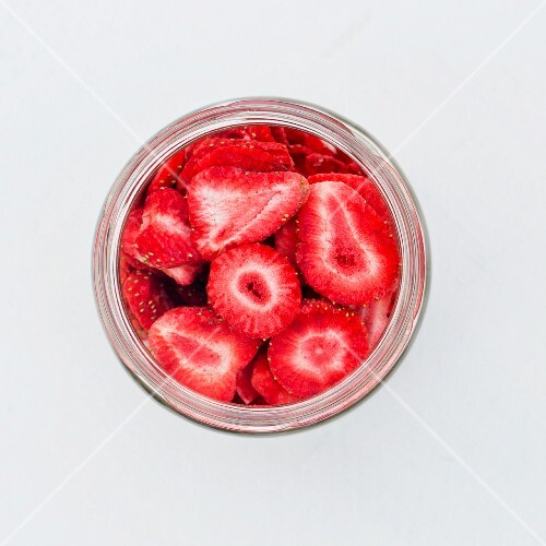 A jar of freeze-dried strawberry slices