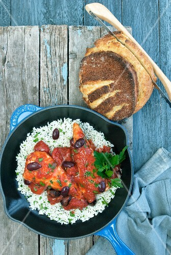 Chicken breast in tomato sauce with olives and rice