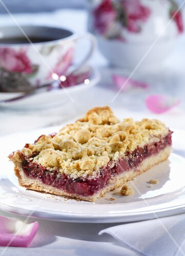 A piece of cherry crumble cake