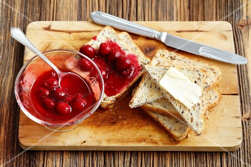 Toast with cherry jam and butter