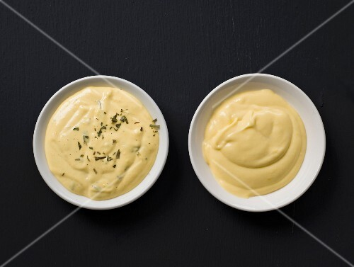 Bowls of Béarnaise and Hollandaise sauce