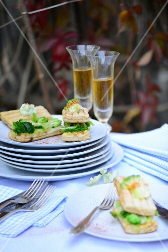 Spicy mille feuilles with broccoli and cheese on a table outside