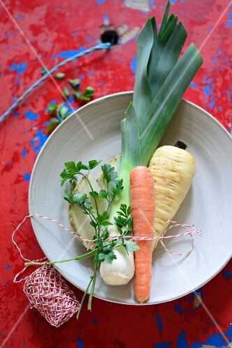 Soup vegetables tied with kitchen twine
