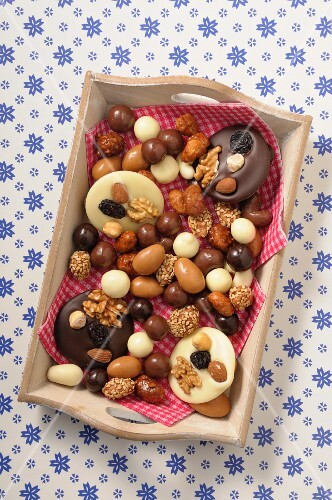 Chocolate confectionery and sweets on a wooden tray