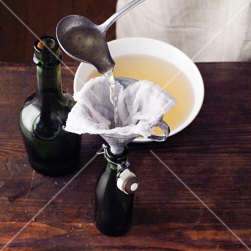 Fennel drink à la Hildegard von Bingen being poured into a bottle