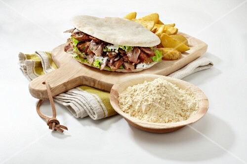A doner kebab on a chopping board