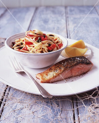 Pasta with a fresh tomato and caper sauce and fried salmon