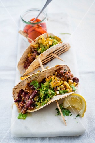 Tacos with vindaloo beans, avocado and sweetcorn