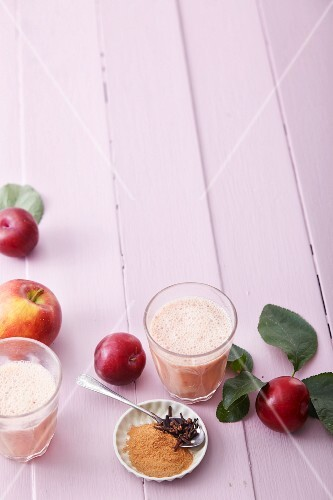 Apple and plum smoothies with almond milk and spices
