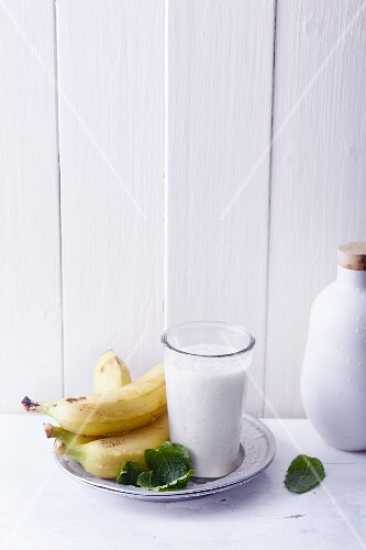 A banana smoothie with mint, almond milk and vanilla