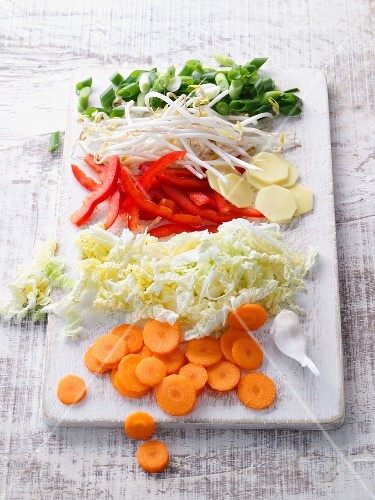 Chopped vegetables for stir-frying on a chopping board