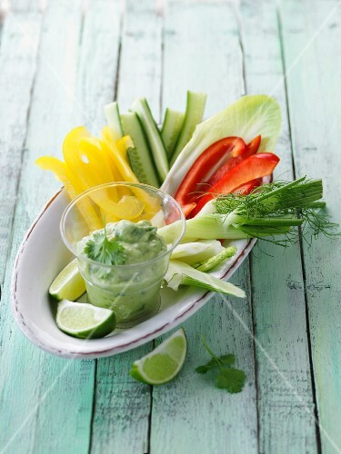 Colourful vegetables sticks with an avocado and yoghurt dip