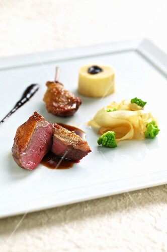Pigeon with pepper sauce and black salsify