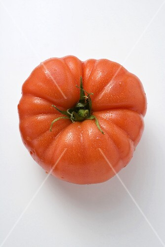 Water drops on a beefsteak tomato (seen from above)