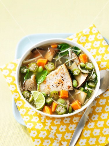 Vegetable soup with mushrooms and grilled fish