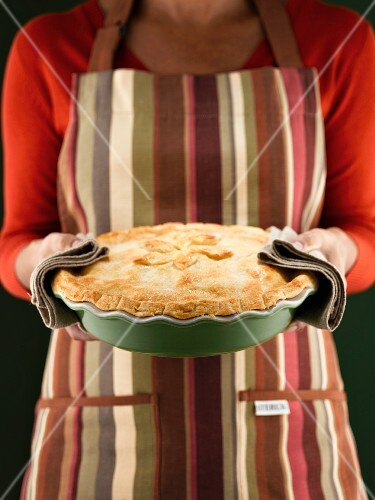 Woman holding freshly-baked pie