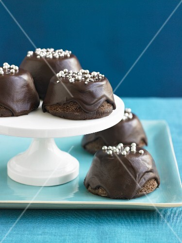 Chocolate Covered Upside Down Cupcakes With Silver Ball Decorations