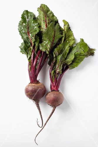 Two beetroots with leaves