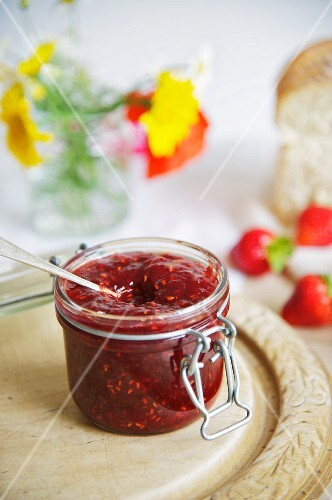 A jar of raspberry and strawberry jam