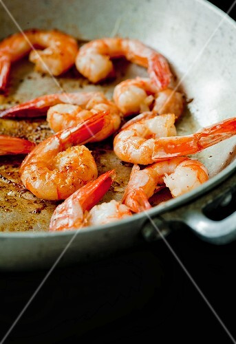Shrimp being fried in a pan