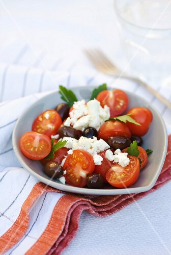 Tomatoes with black olives, feta and parsley