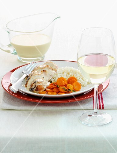 Chicken breast with carrots, rice and citrus sauce