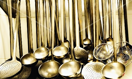 Ladles and strainer spoons in a large kitchen