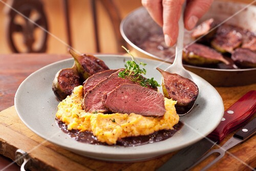 Venison steak with sweet potato puree and figs in red wine