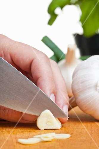 Garlic being sliced
