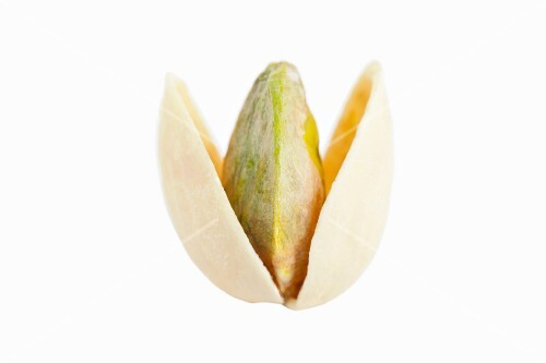 An opened, toasted pistachio against a white background