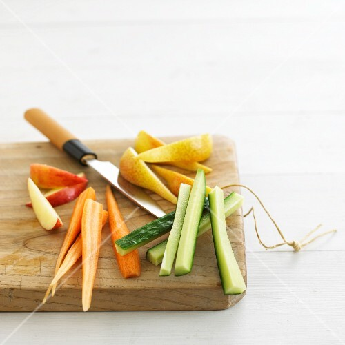Sliced fruit and vegetables on a chopping board