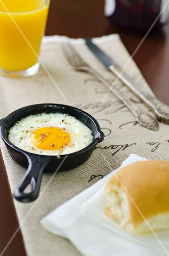 A fried egg in a small pan