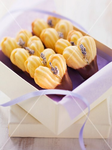 Heart-shaped biscuits decorated with lavender flowers and chocolate glaze
