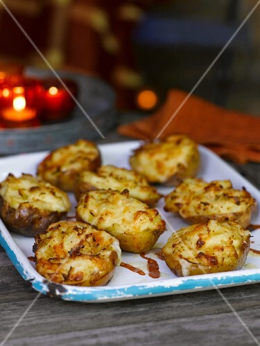 Baked potatoes topped with cheese