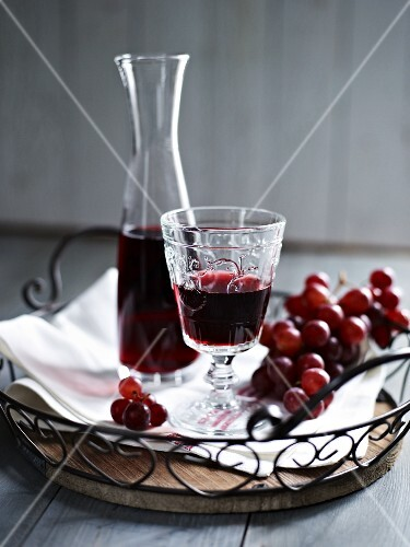 Red wine and red grapes