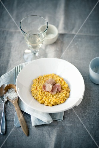 Saffron risotto and beef marrow slices