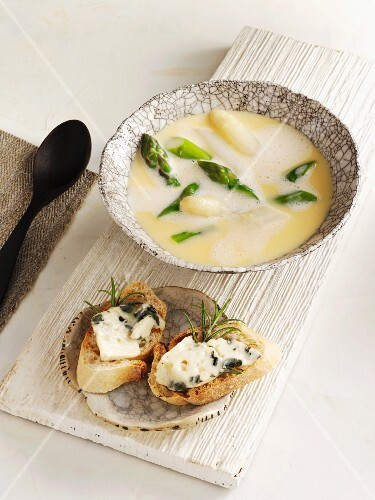 Cream of asparagus soup served with a cheese baguette