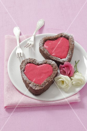 Heart-shaped chocolate cakes with raspberry mousse