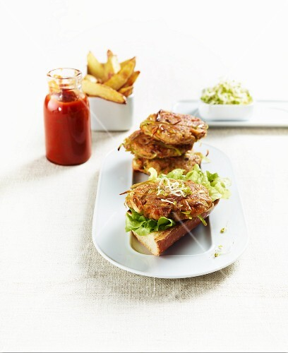Veggie burgers with potato wedges and homemade ketchup