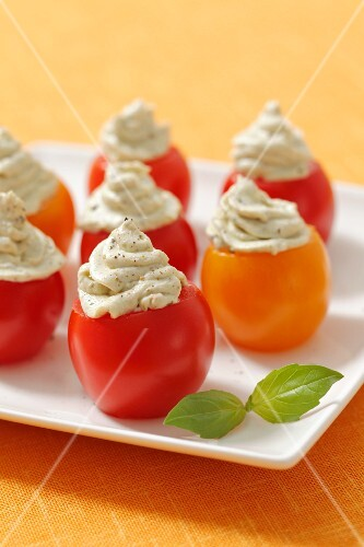 Cherry tomatoes filled with feta-pesto cream