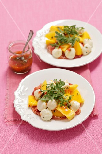 Mango salad with mozzarella, Prosciutto ham and a chilli dressing